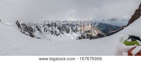 Cloudy pano view from high mountain with tents at Tian Shan mountains, Kyrgyzstan