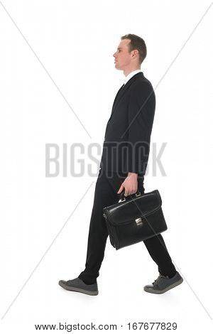 Side view business man walking with briefcase walking by isolated over white background