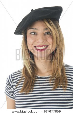 Young French girl with typical French barret and striped shirt isolated over white background