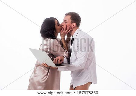 young kissing couple of handsome man or businessman and pretty woman or girl working on portable laptop or computer in shirt gown and tie isolated on white background