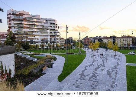 MILAN, ITALY - NOVEMBER 7, 2016: Milan (Lombardy Italy): modern park of Citylife (Tre Torri) at sunset