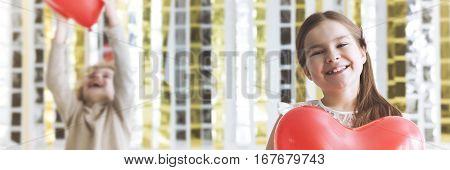 Girl Taking Red Heart