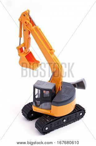 Toy tracked excavator with sand on the tracks