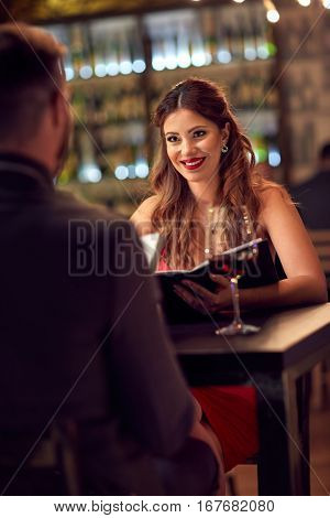 Elegant couple spend romantic evening in restaurant
