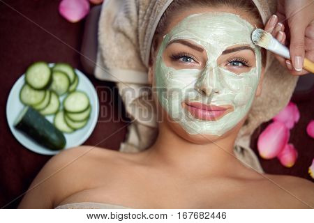 Healthy skin requires care, natural mask on face of beautiful woman