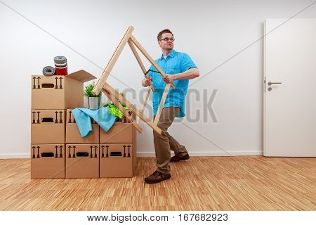 Man fighting with wooden bock. He looks exhausted.