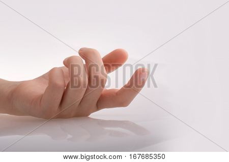 Hand Loosely Pointing On White Background