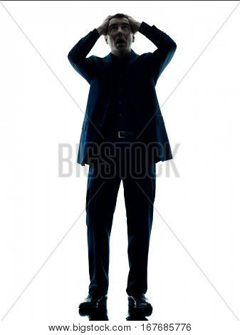 one caucasian business man standing despair silhouette isolated on white background