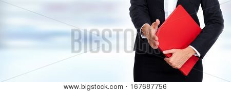 Hands with red folder