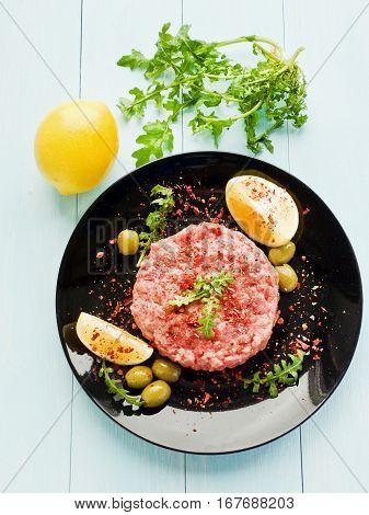 Fresh beef tartar with herbs. Shallow dof.