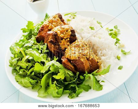 Pork Ribs With Rice And Rucola