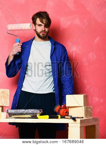 Builder Man Holding Paint Roller