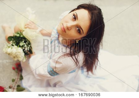 A View From Above On A Stunning Lady With Hazel Eyes In White Ethnic Dress