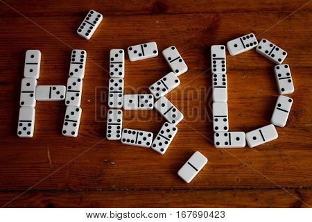 Happy birthday player sign: Domino pieces in shape of happy birthday word on wooden table in black and white style