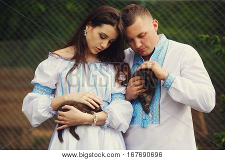 Couple dressed in ethnic style strokes little polecats