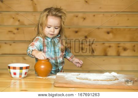 Cute Child Cooking With Dough, Flour, Egg And Bowl