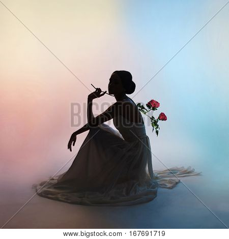 Art fashion studio photo of beautiful elegant woman on colors background. Drawing of shadows and colors. Light and color effects. Fashion style