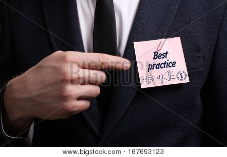 Business, Technology, Internet And Network Concept. Young Businessman Shows The Word: Best Practice