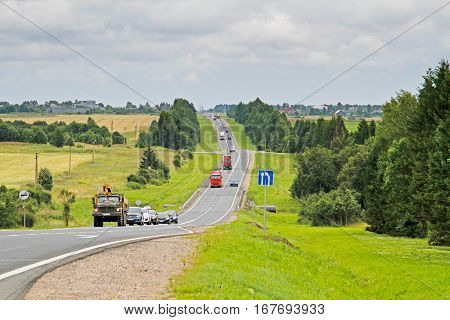 Vologda region Russia - August 03 2015: Cars driving on the track in Vologda region