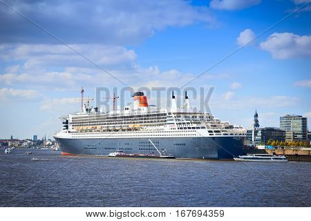 HAMBURG GERMANY - SEPTEMBER 28 2016: Queen Mary 2 cruise ship in the Port of Hamburg Elbe river on September 28 2016