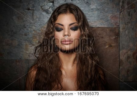 Closeup portrait of wild latin american woman with nose ring.