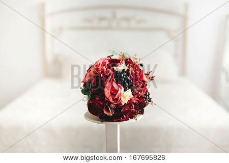 bride's room with wedding red beautiful bouquet