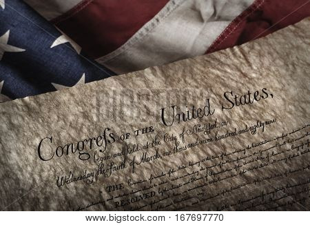 U.S. Bill of rights document on an old and worn US flag