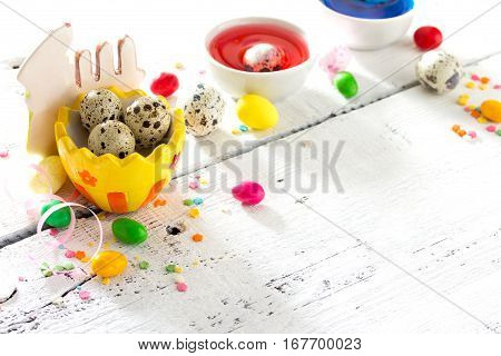 Сooking Recipe Background For Easter Celebration: Quail Eggs Are, Candy And Twigs Of Willow On A Whi