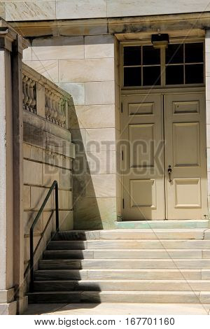 Vertical image of entryway, with stone steps and door into building