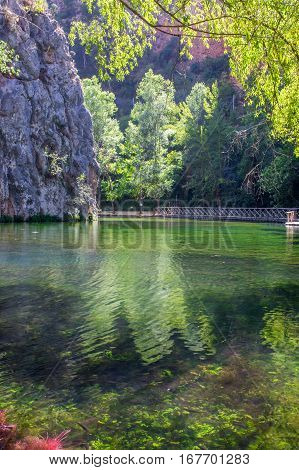 Landscape of the clear mirror lake in the Natural park of Monasterio de Piedra in Nuevalos, Zaragoza, Spain