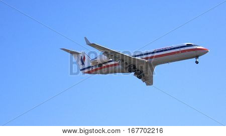 LOS ANGELES, CALIFORNIA, UNITED STATES - OCT 9th, 2014: airplane shown shortly before landing at the LA Airport LAX.