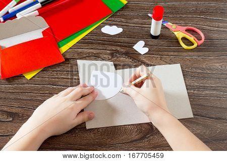 The Child Draws The Details Of Application. Easter Card Letter Cockerel Handmade. Children's Art Pro