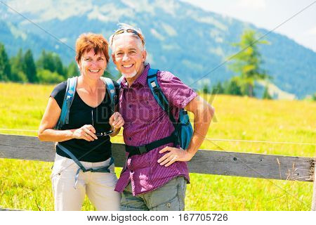 An active snior couple is having fun outdors, enjoying summer.