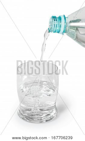 glass filled with a stream of pure spring water. Glass partly filled, the water pours from a transparent plastic bottle. Side view, isolated on white background with slight reflection and shadow.