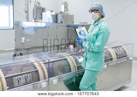 Scientist Standing Near Centrifuge