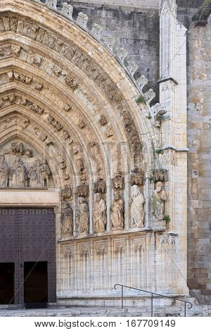 Entrance of the gothic cathedral of Santa Maria in Castello d Empuries Girona province Catalonia Spain