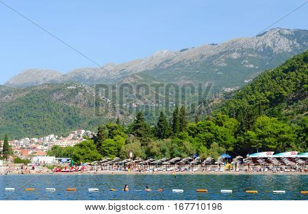 BUDVA MONTENEGRO - SEPTEMBER 19 2015: Beautiful view from sea on Budva coast. Unidentified people are relaxing on beach