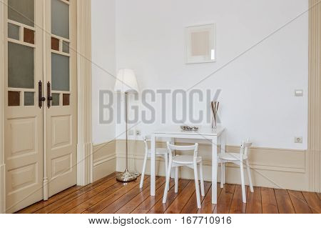 Bright Dining Room With Simple White Table and Chairs