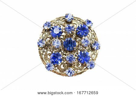 Golden medallion with sapphires and topazes isolated over white