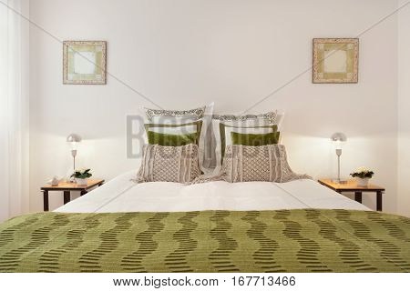 Luxury Bedroom Suite With Green Blanket and Pillows