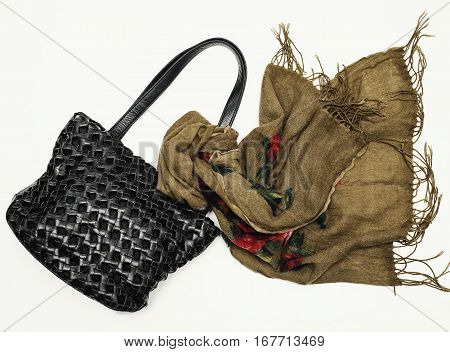 Women's accessory. leather bag and scarf over white