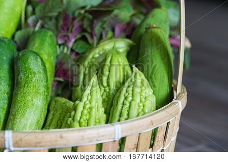 Tropical Green Organic Vegetable On Basket On Wooden Background