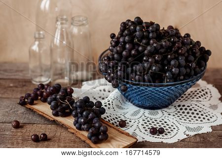 still-life with homegrown grapes on vintage rustic wooden table