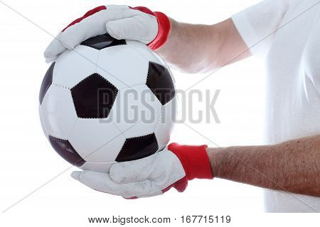 goal keeper takes a soccer ball in hands