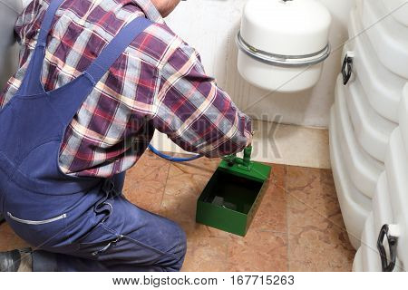 repairman is working on a oil heating