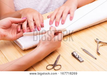 Woman hands during manicure session