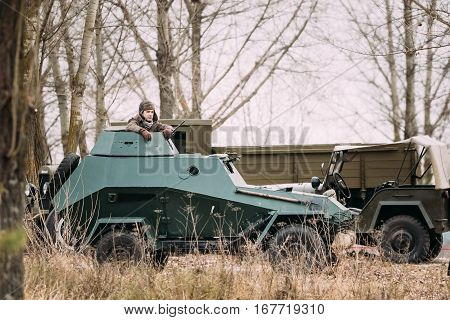 Gomel, Belarus - November 26, 2016: BA-64 Is A Small Lightly Armoured Soviet Scout Car Stands In Autumn Forest.