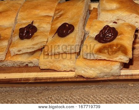 Slices Of Italian Bread With Chocolate Sauce, Sweet And Savoury Italian Snack