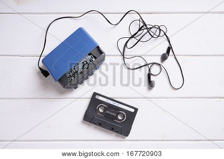 vintage cassette player with earbuds and mix tape