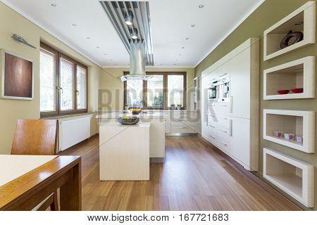 Spacious Kitchen With White Furniture